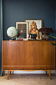 Pictures and ornaments from flea markets on a mid-century sideboard