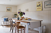 Table in front of wainscoting in a rustic dining room