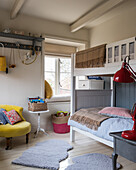 Country-style children's bedroom with loft bed and colour accents