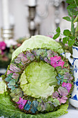 Wreath made of moss and hydrangea blossoms in different colors