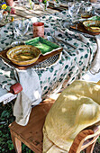 Set table in the garden, view of place setting