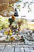 A table laid with flowers in a garden