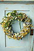 Door wreath of lady's mantle and hydrangea blossoms