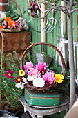 Basket with dahlia blossoms, marigolds and decorative baskets