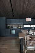 Open kitchen and dining area in the wooden house