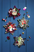 Arrangement of vintage-style stars made from pipe cleaners and shiny scrapbook pictures