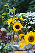 Late summer bouquet of sunflowers, privet berries, aster, twigs and grasses