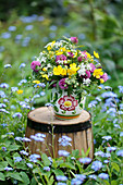 Meadow bouquet of buttercups, red clover and cumin