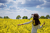 Woman in flowering rape field
