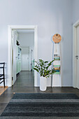 Hallway with floor vase and grandfather clock