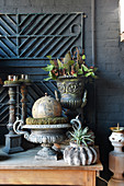 Urns and candlesticks with autumnal decorations