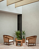 Minimalist seating area with brick floor and grey walls