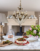French chandelier and marble worktops