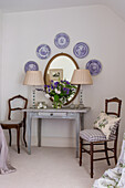 Antique plates displayed above old wooden table