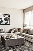 Square ottoman in elegant living room decorated in beige and grey