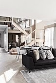 Modern multifunctional interior decorated in shades of grey
