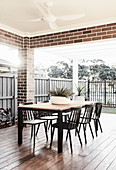 Dining table on roofed terrace in American style