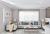 Elegant living room decorated in light grey and pale colours