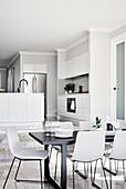 Modern, minimalist, open-plan interior in shades of grey