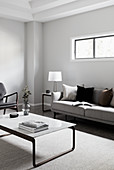 Modern, minimalist living room decorated in shades of grey