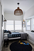 Small boys' room in grey tones with louvre windows