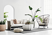 Summery living room in Boho style with houseplants