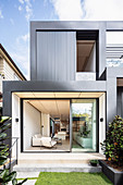 View from garden into modern, cubic, architect-designed house