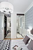Walk-in wardrobe and ensuite bathroom in elegant bathroom