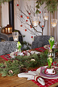 Christmas table decorated with fir branches and hyacinths