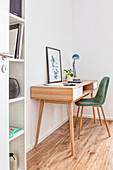 Upholstered chairs at desk in Scandinavian style