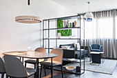 Multifunctional interior with shelves used as partition
