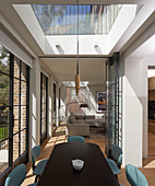 Modern, open-plan interior with skylights and lattice windows