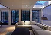 Living room with lattice windows and skylights at twilight