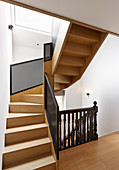 Staircase with old, turned banister spindles and modern balustrade