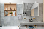 Shelves in niches and twin sinks in grey, modern bathroom