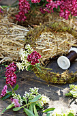 Tie a wreath of privet flowers and carnations