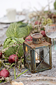 Vintage lantern, red onions and cabbage heads as table decorations