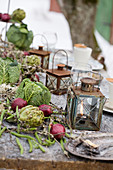 Vintage lanterns, red onions and cabbage heads as table decorations
