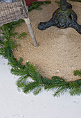 Round outdoor rug decorated with spruce branches