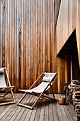 Deck chairs on wooden terrace