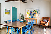 Blue wooden chairs and armchair in dining area