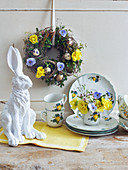 Easter wreath of branches, box, flowers and quail eggs and posy of primulas, violas and lisianthus