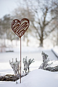 Rusty decorative heart in the snow