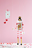 Handmade puppet made from playing cards and drinking straws