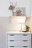 Table lamp on chest of drawers in child's bedroom