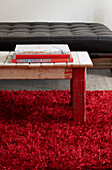 Vintage wooden table in red rug