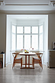 Dining table and classic chair in window bay