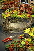 Tying an autumn wreath with knotweed