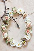 Circular arrangement of roses, narcissus and magnolia twig