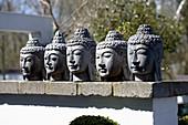 Heads of Buddha in Zen garden